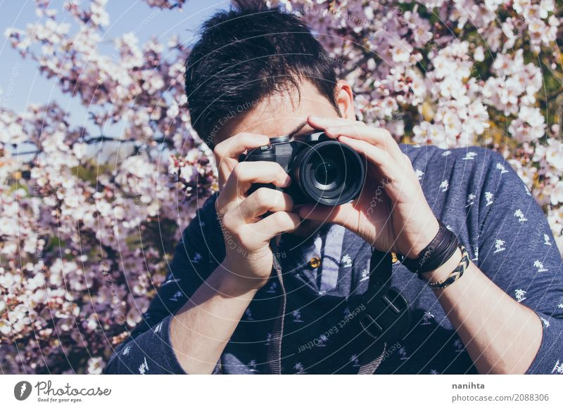 Young man taking photographies Human being Nature Youth (Young adults) Tree Flower 18 - 30 years Adults Life Lifestyle Spring Art Business Leisure and hobbies