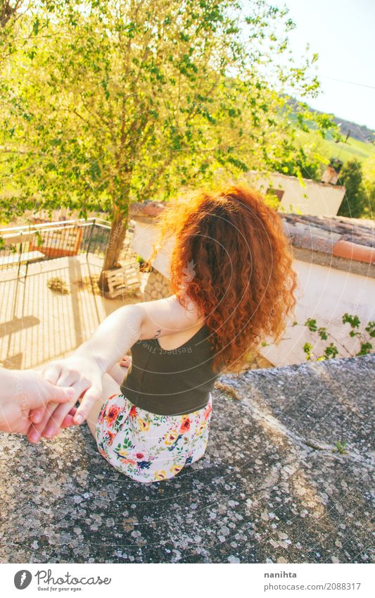 Back view of a young redhead woman holding a hand Human being Vacation & Travel Youth (Young adults) Young woman Summer Green Sun Red Joy 18 - 30 years Adults
