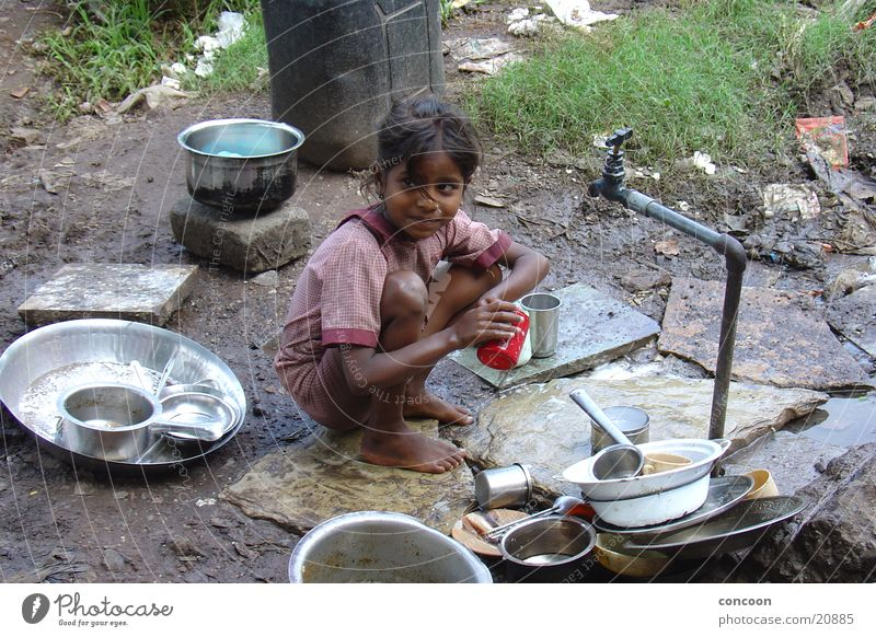 Child Girl Playing Dirty Poverty Earth Slum area Sordid