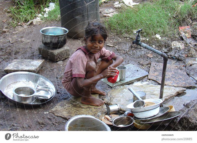Child Girl Playing Dirty Poverty Earth Slum area Sordid