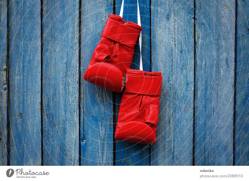 pair of red gloves for kickboxing Old Blue Red Sports Wood Dirty Retro Success Rope Protection Symbols and metaphors Conceptual design Competition Leather Gloves Rustic