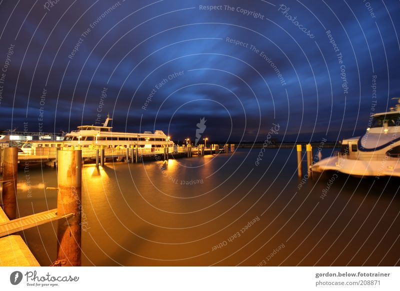 12 o'clock at night Sky Clouds Night sky Lake Lake Constance Means of transport Navigation Boating trip Passenger ship Harbour Blue Gold Colour photo