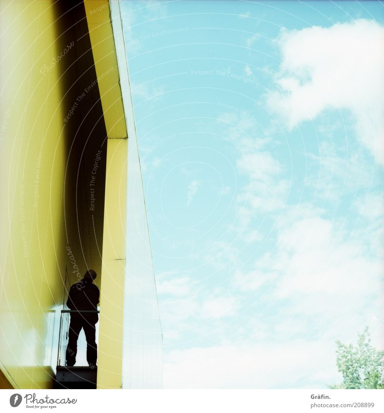Human being Sky Blue House (Residential Structure) Clouds Loneliness Yellow Bright Masculine Design Facade Stand Idyll Curiosity Discover Surrealism