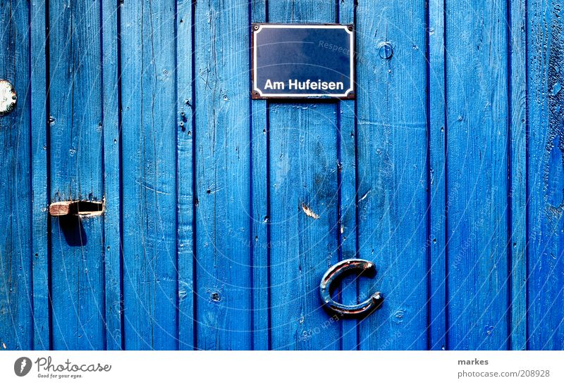 @home Door Blue Happy Colour Surrealism Horseshoe Name plate Bright light Colour photo Exterior shot Deserted Day Sunlight Deep depth of field