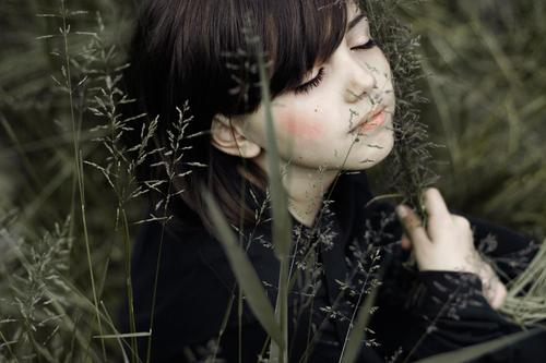Human being Beautiful Plant Calm Face Relaxation Dark Feminine Emotions Grass Head Dream Moody Sit Natural Touch