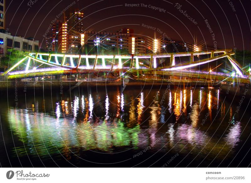 The bridge at... (9915km away from Germany) Steel Multicoloured Evening Physics Thailand Singapore Architecture Bridge Colour River spieglung Warmth