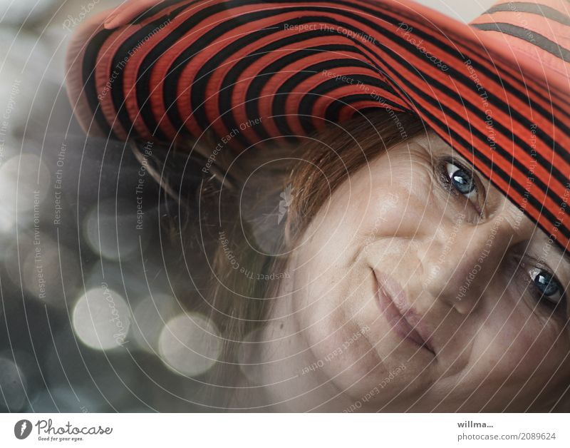 Dreamy portrait of happy smiling woman with blue eyes and red hat Happy Human being Feminine Woman Adults Face Hat Smiling Emotions Happiness Contentment