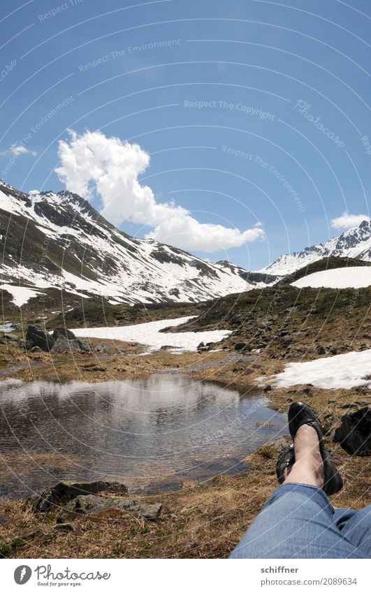 Watching the cloud worm Human being Legs Feet 1 Environment Nature Landscape Sky Clouds Beautiful weather Snow Rock Alps Mountain Peak Snowcapped peak Pond Lake
