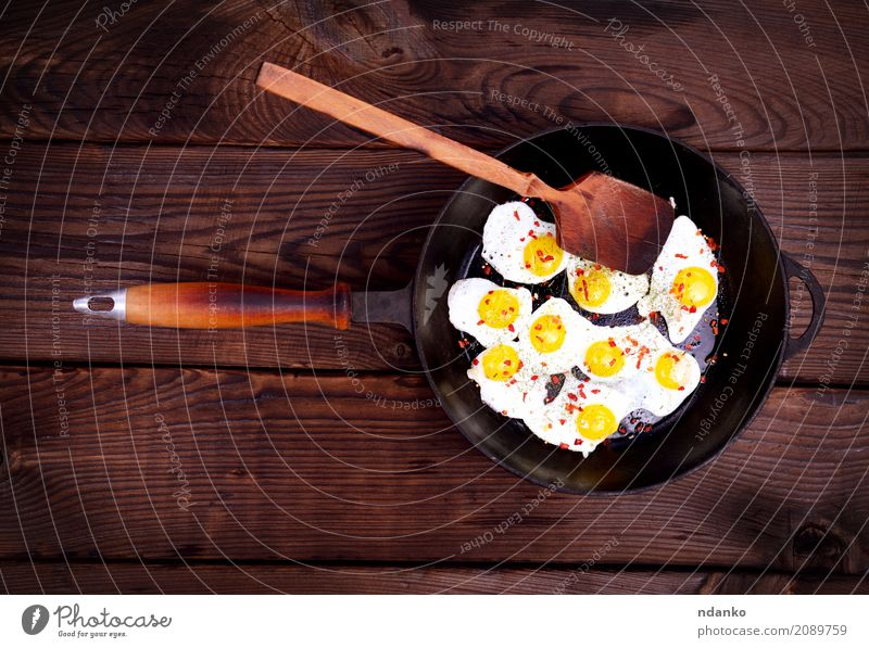 Fried quail eggs Meat Herbs and spices Eating Breakfast Pan Spoon Table Kitchen Wood Natural Above Retro Brown Egg Yolk Protein frying pan Frying food cook