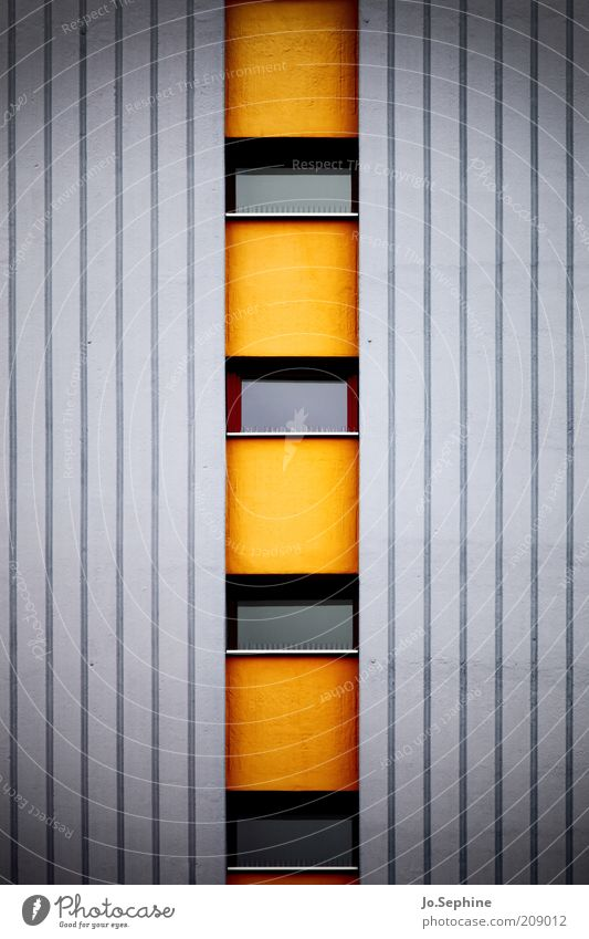 13th floor left House (Residential Structure) High-rise Architecture Wall (barrier) Wall (building) Facade Window Concrete Sharp-edged Gray Orange Stripe Yellow
