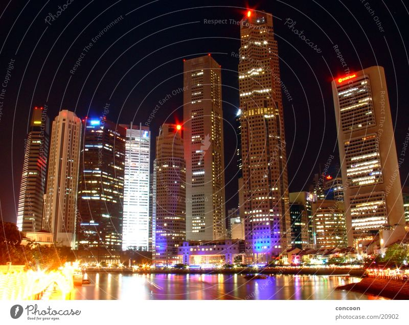 The colourful skyscrapers of Singapore High-rise Multicoloured Modern architecture Thailand Los Angeles Skyline Glass night lighting Light Architecture Town