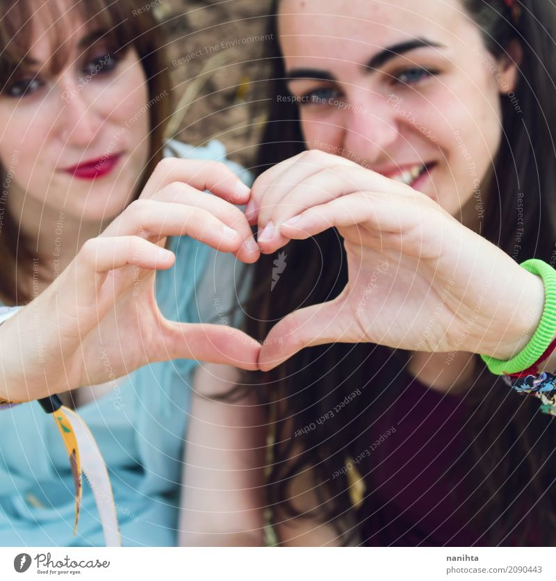 Two friends making a heart with their hands Human being Youth (Young adults) Young woman Beautiful Joy 18 - 30 years Adults Lifestyle Healthy Love Feminine