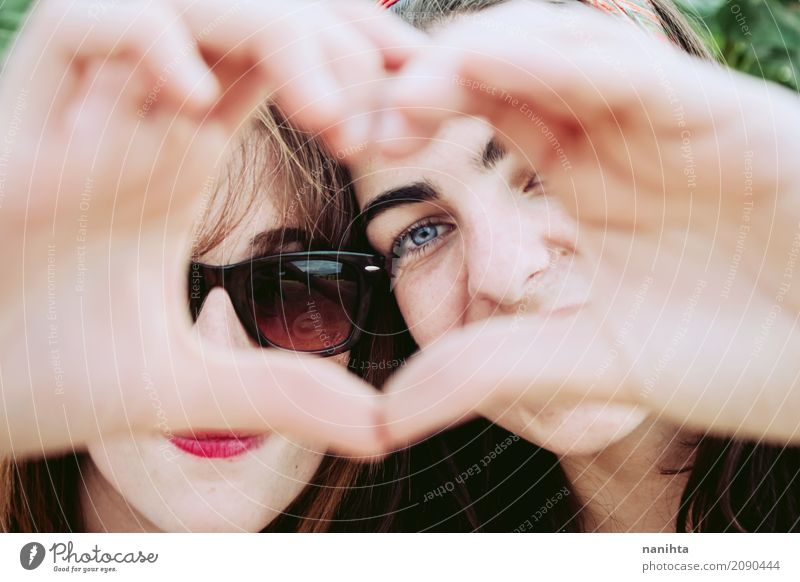 Two young women making a heart with their hands Human being Youth (Young adults) Young woman Beautiful Joy 18 - 30 years Face Adults Life Lifestyle Healthy Love
