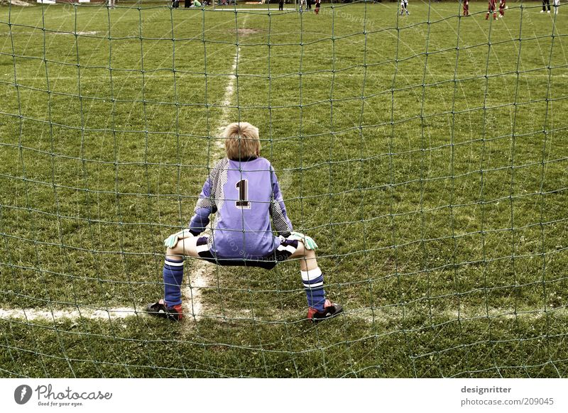 Child Youth (Young adults) Calm Sports Boy (child) Playing Grass Soccer Wait Sports team Lawn Observe Infancy Brave Goal Expectation