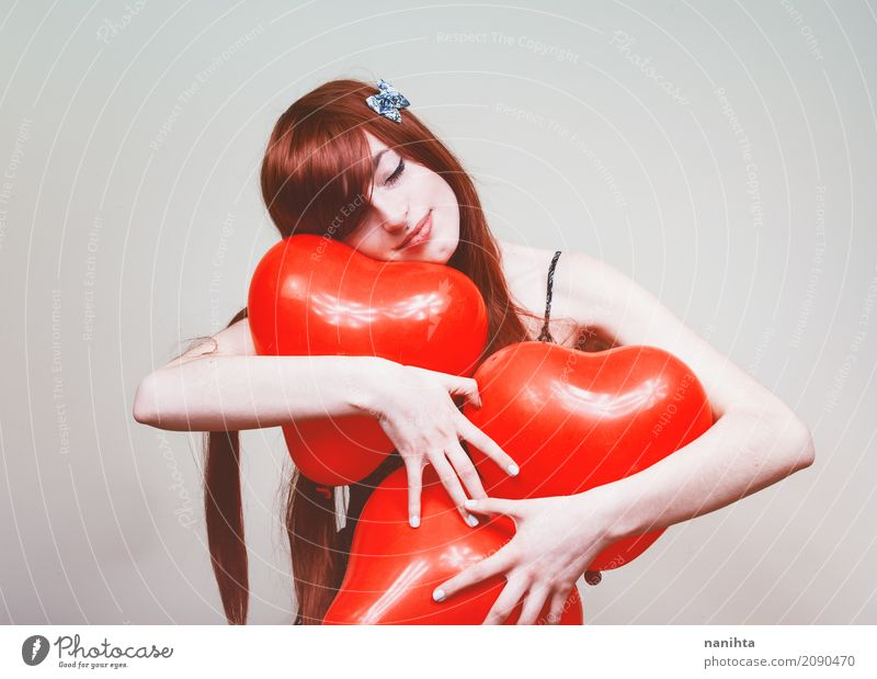 Young redhead woman hugging heart balloons Human being Youth (Young adults) Young woman Beautiful White Red 18 - 30 years Adults Love Healthy Feminine