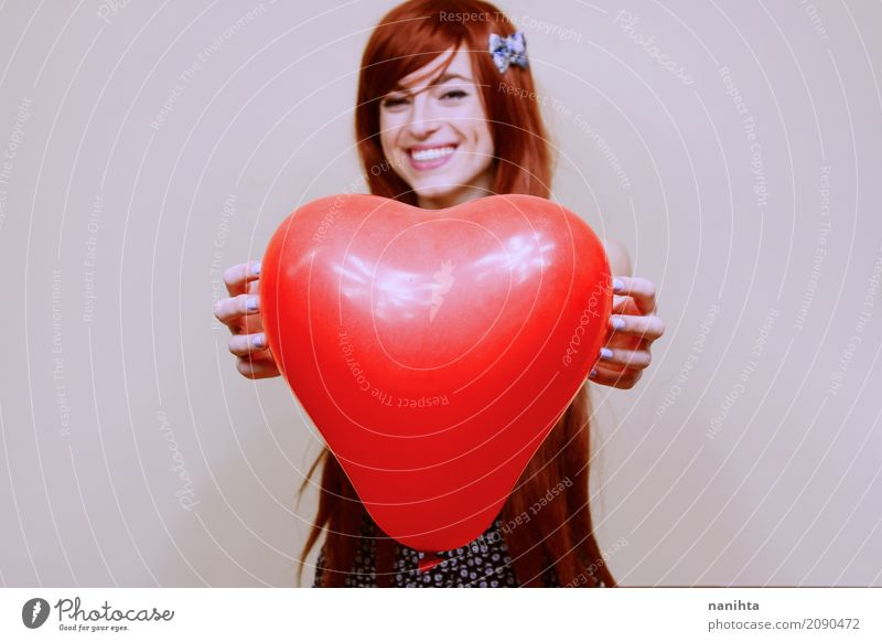 Young woman holding a red heart shaped balloon Human being Youth (Young adults) Beautiful Red Joy 18 - 30 years Adults Lifestyle Love Feminine Happy