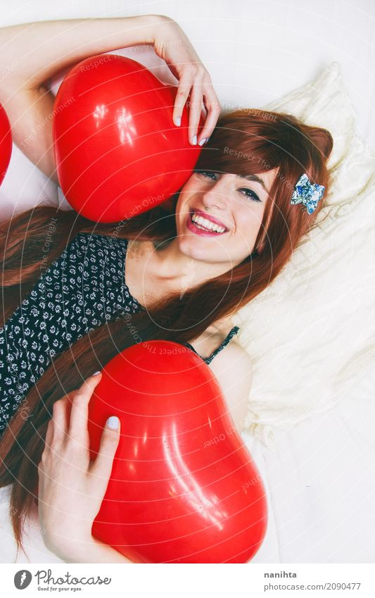 Young redhead woman hugging red heart shaped balloons Human being Youth (Young adults) Young woman Beautiful White Red 18 - 30 years Adults Life Lifestyle Love