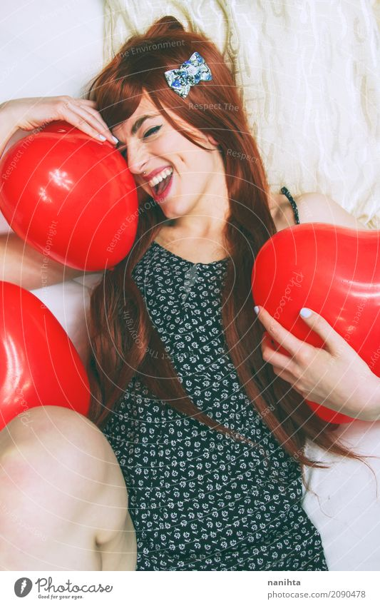Young redhead and cheerful woman hugging balloons Human being Youth (Young adults) Young woman Beautiful White Red Joy 18 - 30 years Black Adults Life Lifestyle