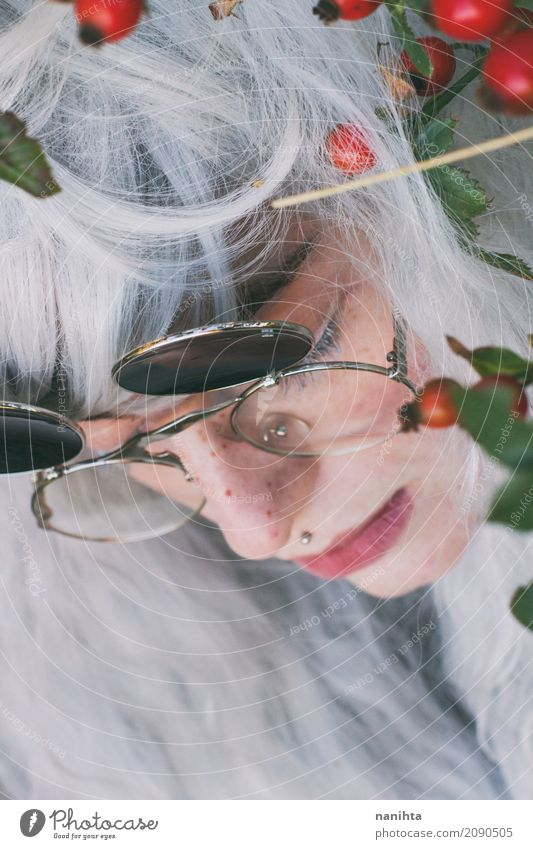 Profile of a pretty young woman with white hair Human being Youth (Young adults) Young woman Beautiful Green White Red Leaf 18 - 30 years Face Adults Autumn
