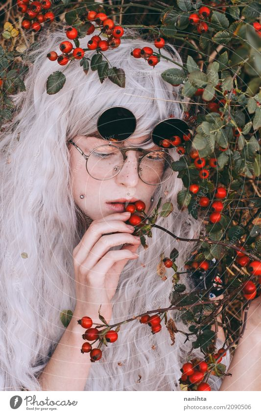 Young woman eating wild berries Human being Nature Youth (Young adults) Plant Green White Red 18 - 30 years Adults Eating Autumn Feminine Food Fashion Fruit