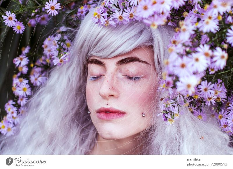 Artistic young woman portrait with a lot of purple flowers Feminine Youth (Young adults) 1 Human being 18 - 30 years Adults Environment Nature Plant Flower
