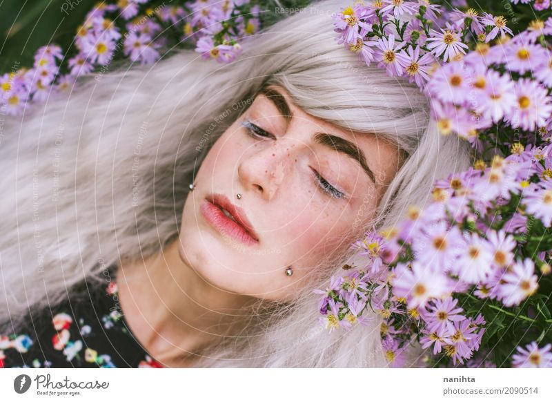 Young woman posing with purple flowers Elegant Face Freckles Senses Relaxation Fragrance Human being Feminine Youth (Young adults) 1 18 - 30 years Adults