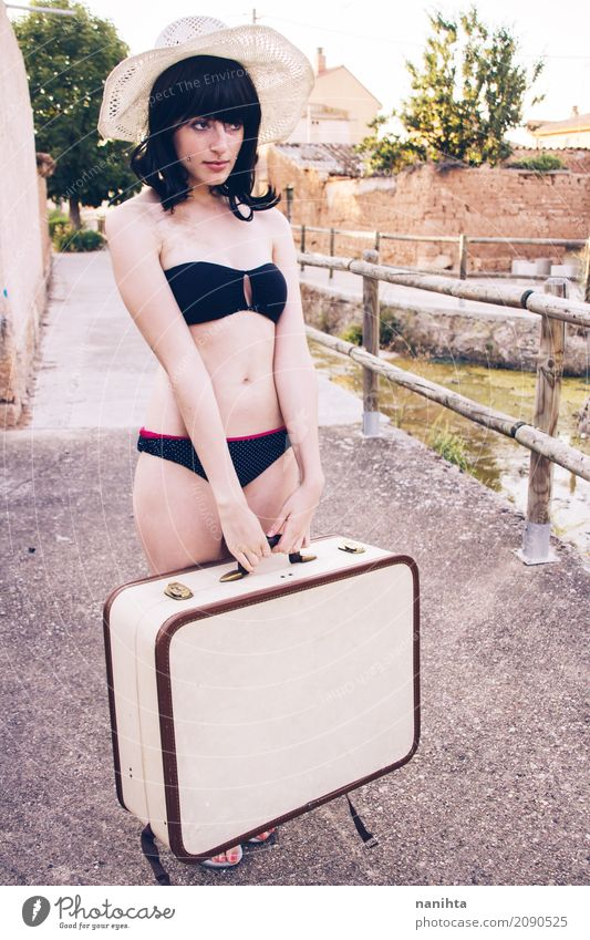 Young woman wearing a bikini and holding a suitcase Human being Vacation & Travel Youth (Young adults) Summer Beautiful 18 - 30 years Adults Lifestyle Feminine