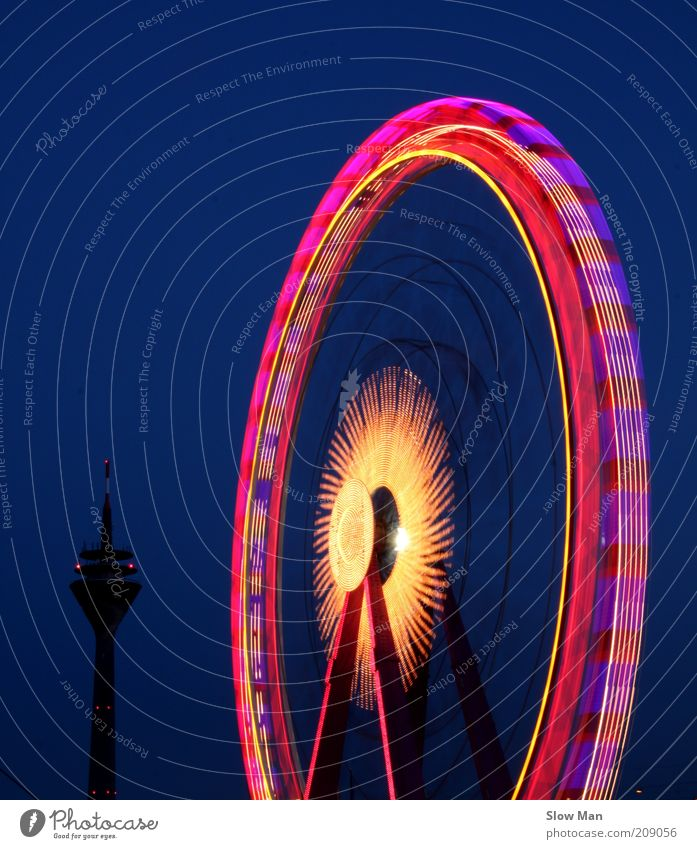 Leisure and hobbies Speed Circle Rotate Fairs & Carnivals Wheel Duesseldorf Night sky Television tower Ferris wheel Carousel Long exposure Circular Night shot Tracer path Amusement Park