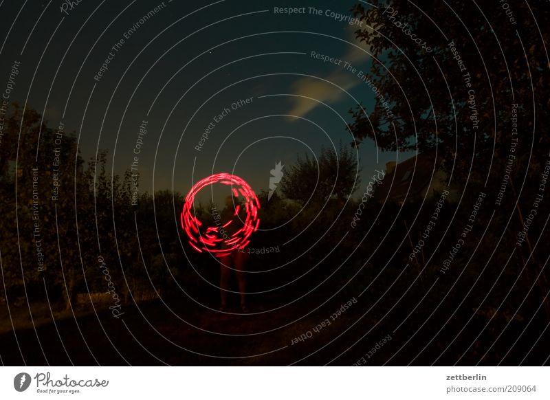 Playing around at night Garden Human being Nature Park Joy Illuminate Circle Tracer path Magic Enchanting Light show Round Line Dynamics Night sky Glint