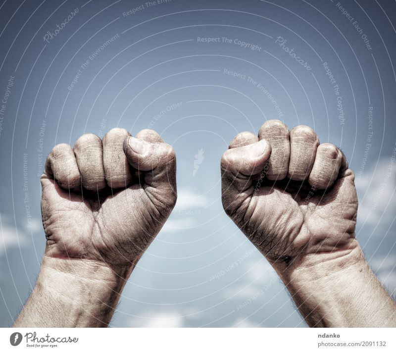 Two dirty male hands clenched in fist Freedom Hand Fingers 18 - 30 years Youth (Young adults) Adults Sky Aggression Dirty Strong Blue Black Power Might
