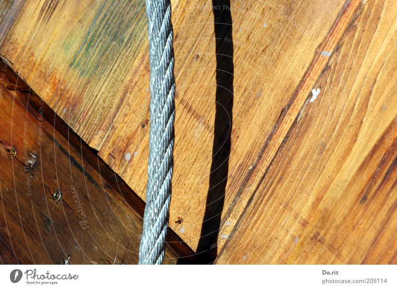 roped parties Wood Steel Rope Colour photo Exterior shot Light Shadow Sunlight Wooden board Steel cable Parallel Equality Progress Day