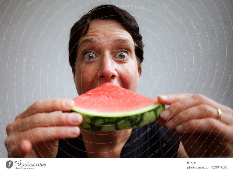Not so young caucasian happy smiling woman eating watermelon Fruit Melon Water melon Nutrition Eating Organic produce Vegetarian diet Finger food Lifestyle
