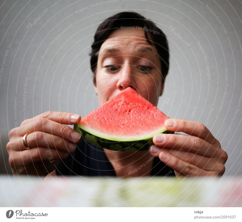 Not so young caucasian woman now almost biting in watermelon Fruit Water melon Melon Nutrition Eating Vegetarian diet Finger food Woman Adults Life Face Hand 1