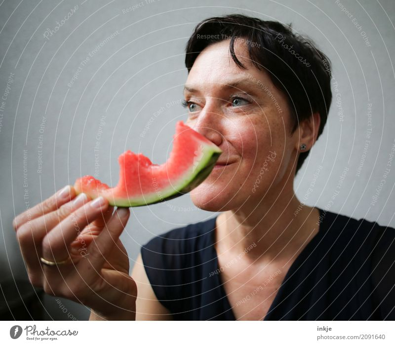 Amused happy smiling caucasian woman still chewing watermelon Fruit Water melon Melon Nutrition Eating Organic produce Vegetarian diet Slow food Finger food