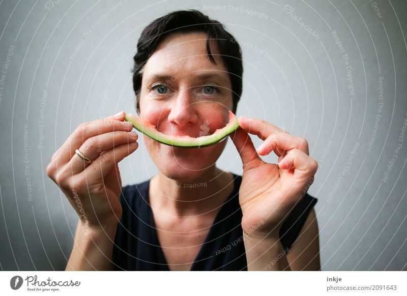 not so young caucasian smiling woman with rest of watermelon Fruit Water melon Melon Sheath Nutrition Eating Organic produce Vegetarian diet Finger food Woman
