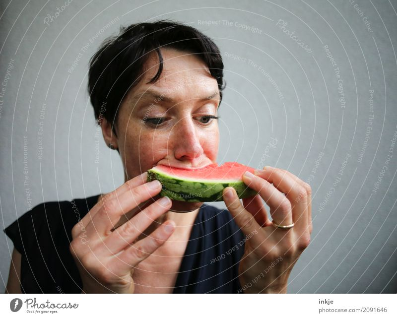 Not so beautiful looking but happy caucasian woman eating Fruit Water melon Melon Nutrition Eating Organic produce Vegetarian diet Finger food Woman Adults Life