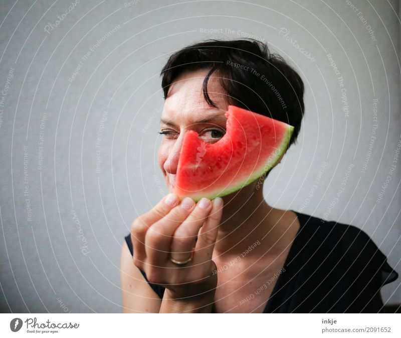 funny happy caucasian woman looking through watermelon Fruit Melon Water melon Nutrition Eating Organic produce Vegetarian diet Finger food Lifestyle Joy Woman