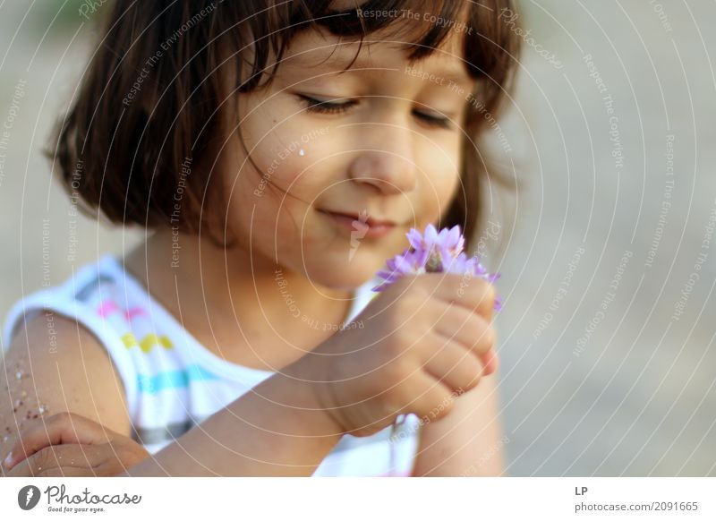 little girl observing flowers Human being Child Flower Relaxation Calm Joy Girl Adults Life Lifestyle Emotions Family & Relations School Feasts & Celebrations