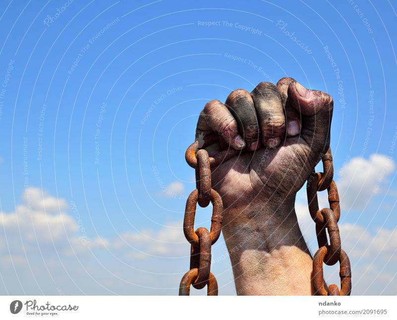 Rusty iron chain in human male right hand Sky Old Blue Hand Black Freedom Brown Metal Masculine Dirty Power Skin Fingers Idea Protection Might