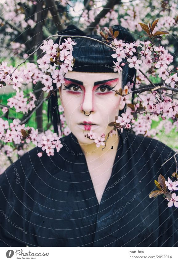 Young woman with geisha makeup posing with flowers Human being Nature Youth (Young adults) Beautiful Tree Flower 18 - 30 years Face Adults Environment Spring