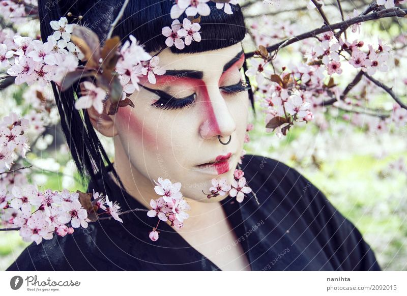 Young woman wearing geisha make up Human being Nature Youth (Young adults) Beautiful Tree Flower 18 - 30 years Face Adults Environment Spring Feminine Style Art