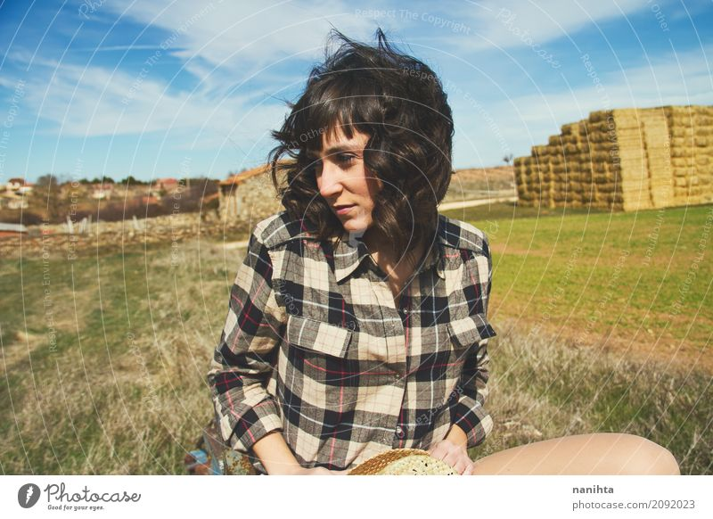 Beautiful cowgirl in a rural landscape Human being Sky Nature Youth (Young adults) Blue Young woman Green Landscape Relaxation 18 - 30 years Adults Life
