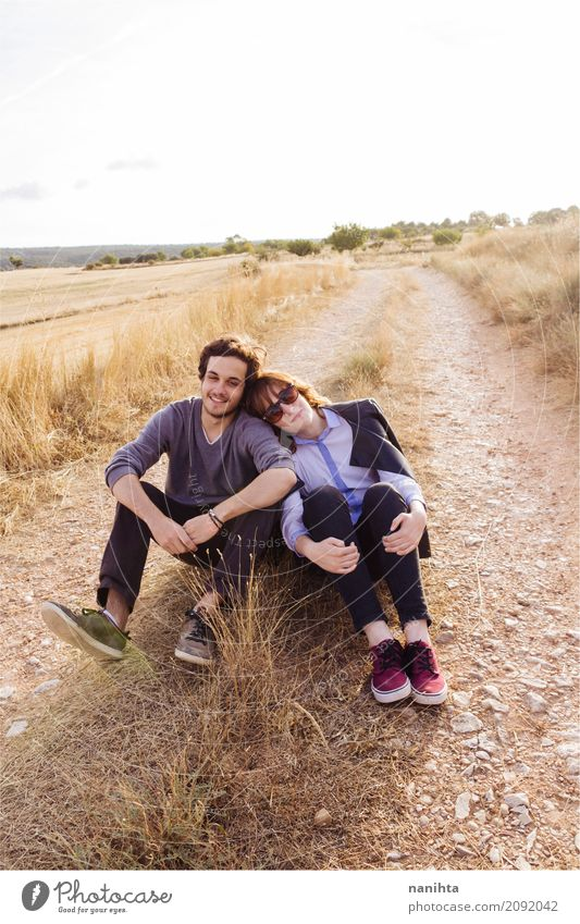 Young couple sitting together in a rural path Lifestyle Style Wellness Well-being Relaxation Human being Masculine Feminine Young woman Youth (Young adults)