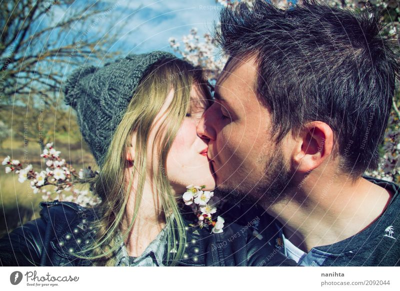 Young hipster couple kissing Human being Youth (Young adults) Young woman Sun Young man Flower 18 - 30 years Adults Environment Life Lifestyle Spring Love