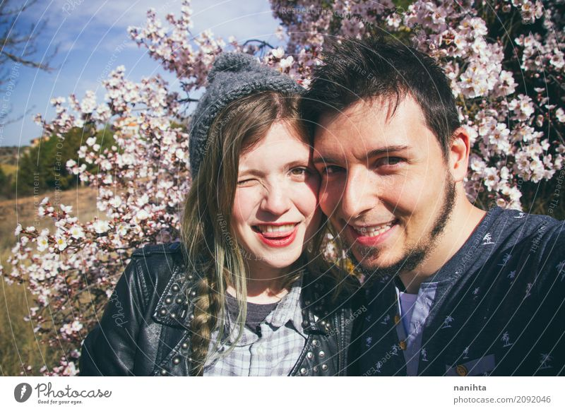 Young couple so happy together Human being Youth (Young adults) Young woman Summer Young man Tree Flower Joy 18 - 30 years Adults Lifestyle Spring Funny Love