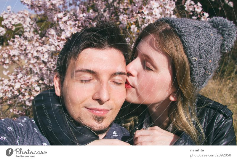 Young woman kissing her boyfriend Human being Youth (Young adults) Young man Relaxation 18 - 30 years Adults Life Lifestyle Love Emotions Feminine Style Couple