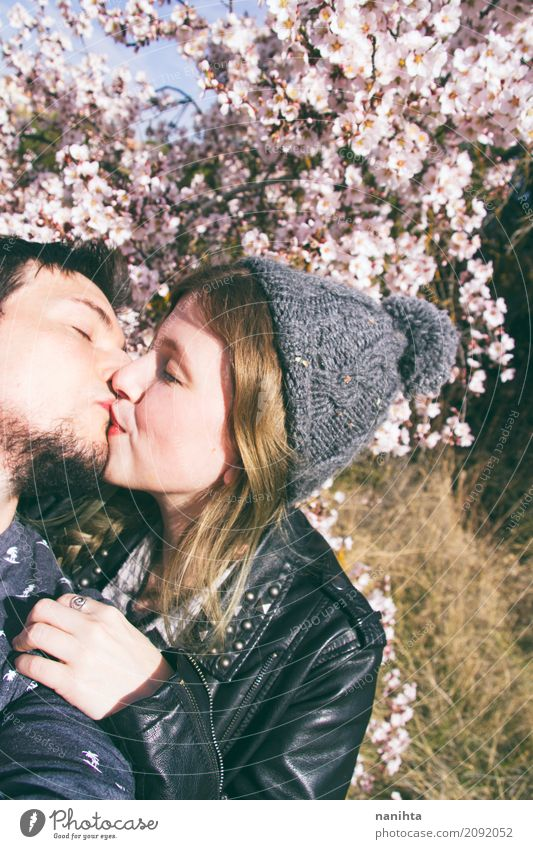 Young couple kissing Human being Nature Youth (Young adults) Young woman Young man Tree Flower Joy 18 - 30 years Adults Environment Life Lifestyle Spring Love