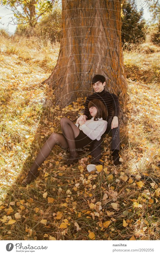 Young couple having a romantic date in a park at autumn Human being Nature Vacation & Travel Youth (Young adults) Young woman Beautiful Young man Tree Leaf