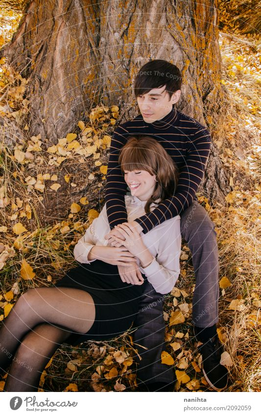 Young couple enjoying an autumn day together Human being Nature Vacation & Travel Youth (Young adults) Young woman Summer Young man Leaf Joy 18 - 30 years