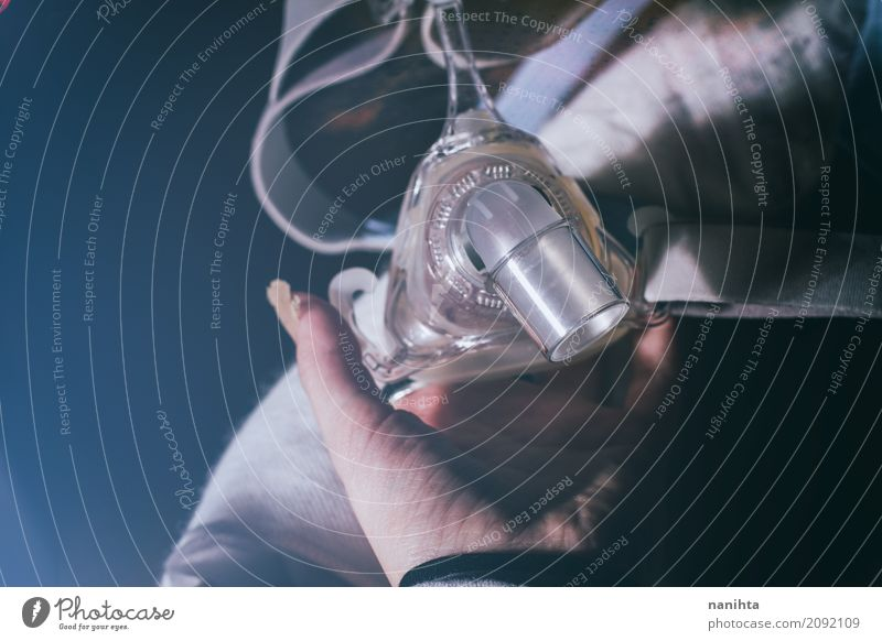 Hand holding a oxygen mask Old Black Healthy Feminine Health care Gray Moody Fear Gloomy Authentic Perspective Fingers Observe Touch Protection